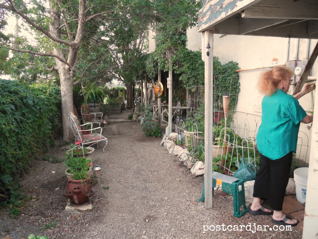 Jeanne tends to her garden behind The Olde Main Street Inn. (Photo by Ann Teget for postcard jar.com)