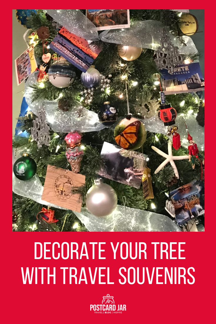 Learn how to decorate your Christmas tree with souvenirs from the places you've traveled. It's a great way to reminisce about the places you've been and the memories you made there. #travel #decoratingwithtravel #christmastreethemes #decoratingforchristmas #christmasdecor #christmastree #traveler