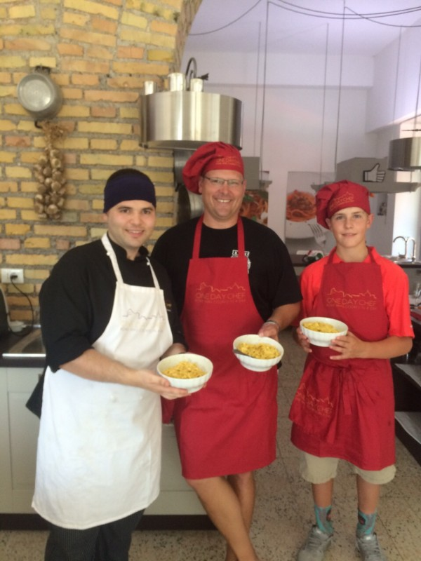 Paul (center) and his son Connor (right) enjoyed learning how to make fresh pasta and sauces from experts in Italy.