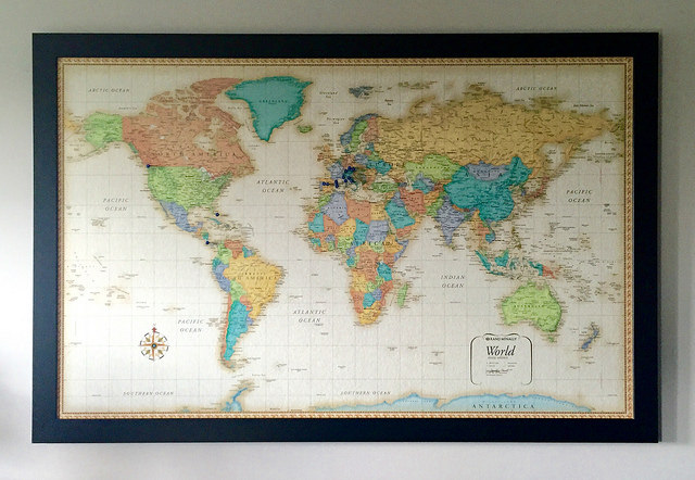 We display our world map in our family room and add numbered pins to the new places we travel to each year.