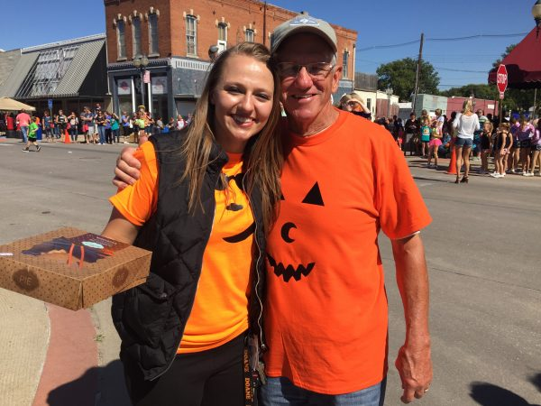 Crete Chamber of Commerce Executive Director Kayleigh Schadwinkel and Pumpkin Master Russ Sears.