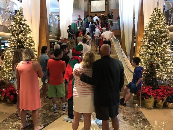 Celebrity Cruises had the Grand Foyer beautifully decorated for Christmas and Santa was there to give gifts to all of the children on board. From what we saw, the older kids received beach towels and the younger ones got plush toys.