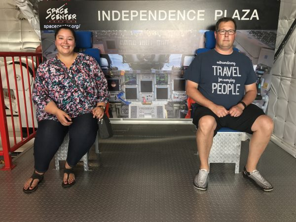 Trying out flight seats at Space Center Houston