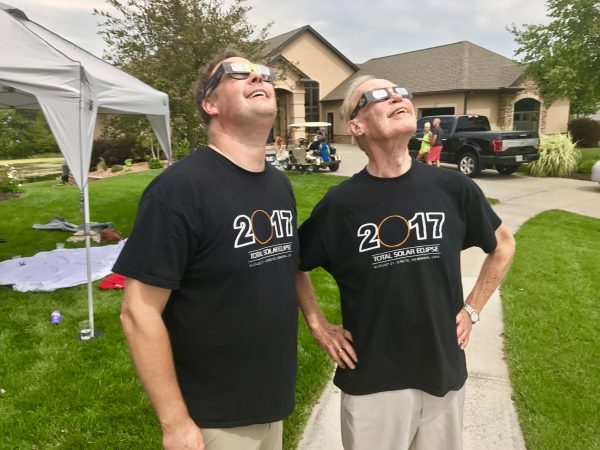 Steve and his dad, John Teget, watch the total solar eclipse from our front yard in Crete, Nebraska.