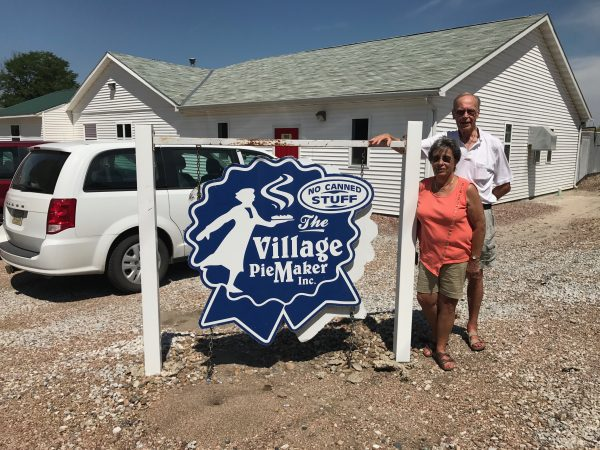 Steve's parents John and Gayle Teget outside The Village Pie Maker shop in Eustis, Nebraska.