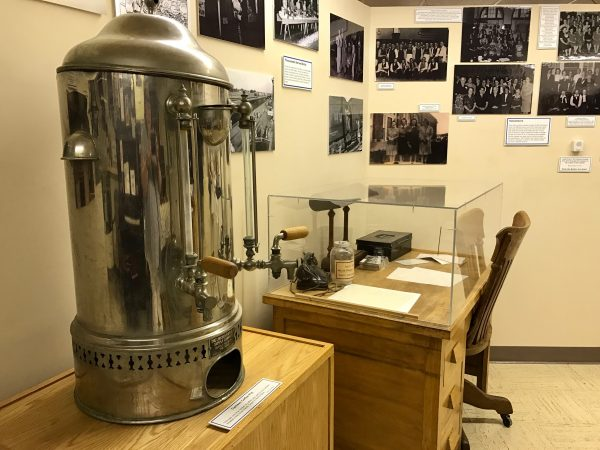 Memorabilia from the North Platte Canteen, including this silver coffee pot.