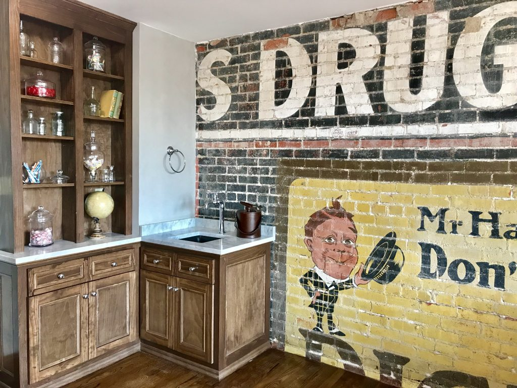 The Drug Store Suite was amazing! The uncovered mural, the apothecary jars, oh, my!