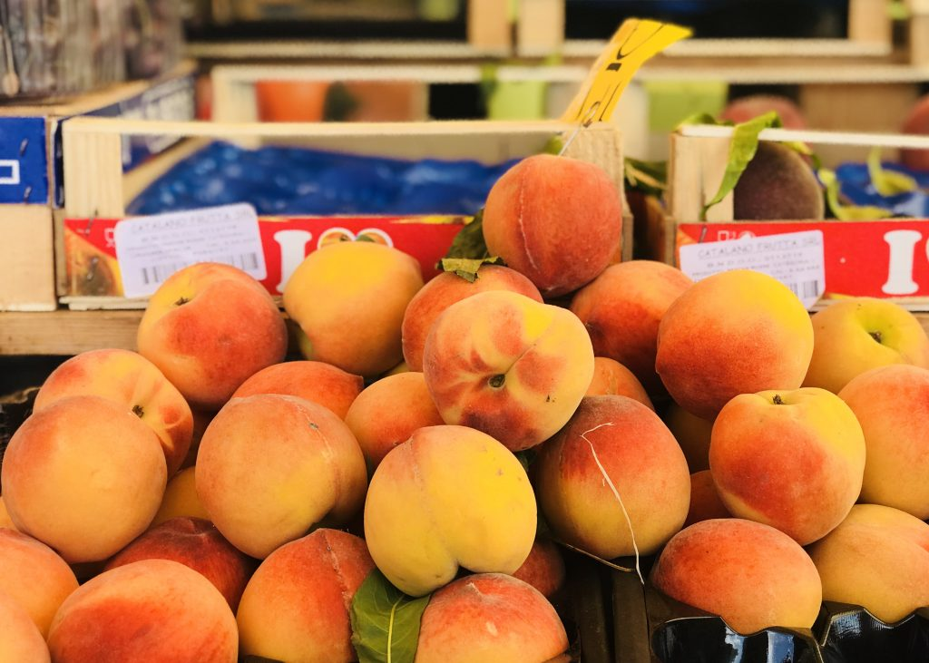 Peaches in the farmers' market, Siena, Italy.