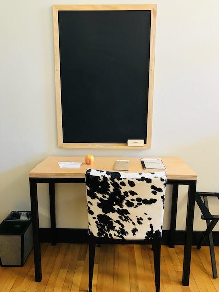 Hotel Grinnell Iowa desk and blackboard