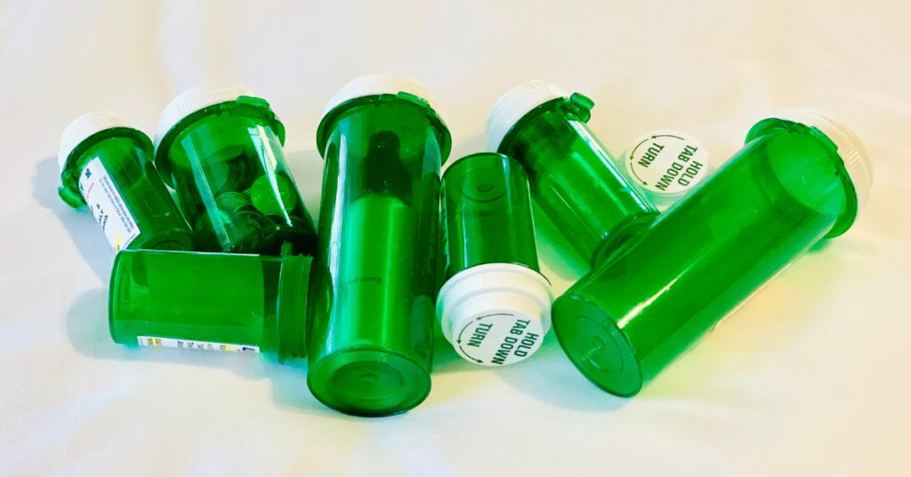 travel tip empty pill bottles