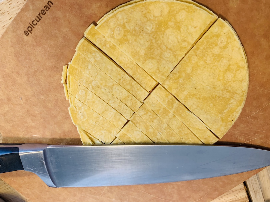 Cutting tortilla for chicken tortilla soup