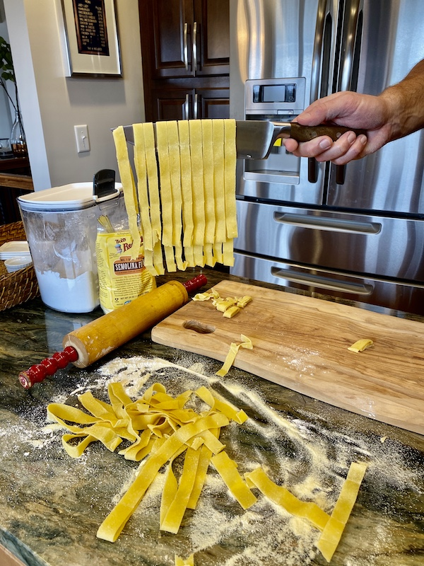 Pasta cut hanging on the knife