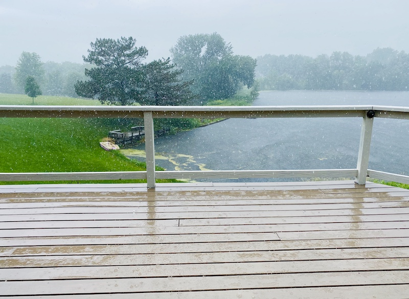 Rain falling hard on RockSolid deck resurfacer