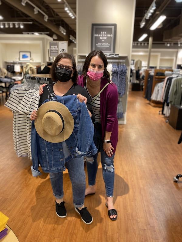 Ann and Kalsey choosing a hat at Banana Republic Legends Outlets Kansas City