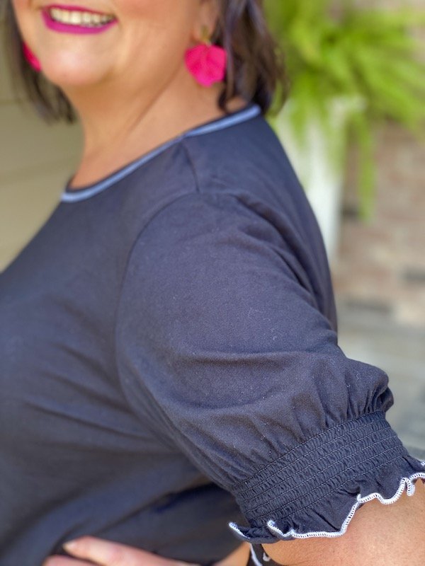 Black top sleeve closeup